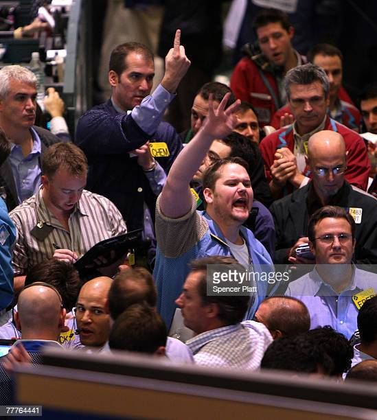 Traders work in the crude options pit on the floor of the New York Mercantile Exchange November 7 2007 in New York City Crude oil prices continued to...