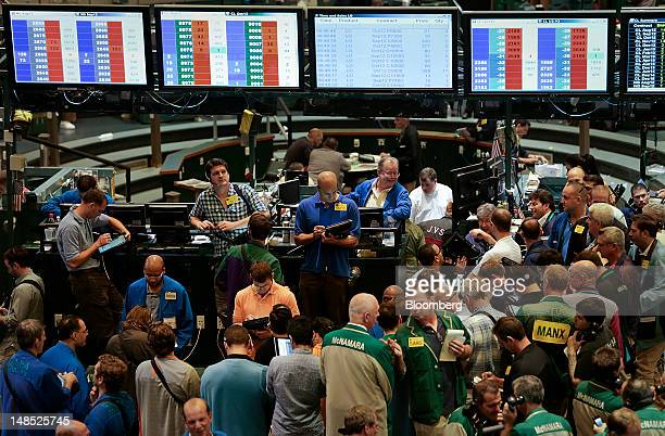 Traders work in the energy options pit at the New York Mercantile Exchange in New York US on Wednesday July 18 2012 Gasoline rose and heating oil...