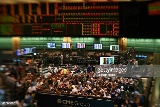 Traders work in the energy options pit on the floor of the New York Mercantile Exchange on August 28 2008 in New York City Tropical storm Gustav may...