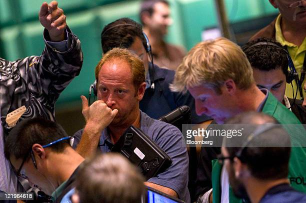 Traders work in the gold and silver options pit at the New York Mercantile Exchange in New York US on Wednesday Aug 24 2011 Gold plunged in New York...