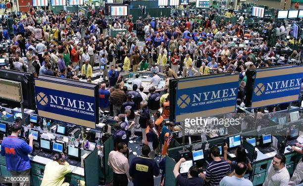 Traders work in the oil trading pit at the New York Mercantile Exchange August 7 2006 in New York City Oil prices rose dramatically as British...