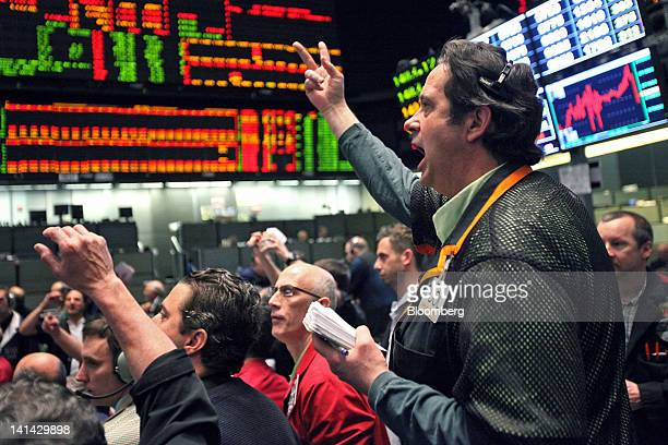 Traders work in the SP 500 pit of the CME Group's Chicago Board of Trade in Chicago Illinois US on Friday March 16 2012 US stocks were little changed...