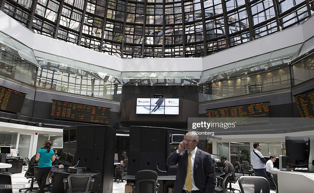 Traders work in the trading gallery of Bolsa Mexicana de Valores (BMV), Mexico's stock exchange, in Mexico City, Mexico, on Wednesday, July 31, 2013. Mexico's economy is forecast to grow 2.8 percent this year based on analyst estimates compiled by Bloomberg. Photographer: Susana Gonzalez/Bloomberg via Getty Images