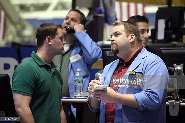 Traders work in the Volatility Index Options pit on the floor of the Chicago Board Options Exchange in Chicago Illinois US on Tuesday April 12 2011...