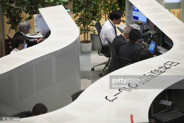 Traders work inside the Tokyo Stock Exchange operated by Japan Exchange Group Inc in Tokyo Japan on Friday Feb 9 2018 The Topix index headed for its...