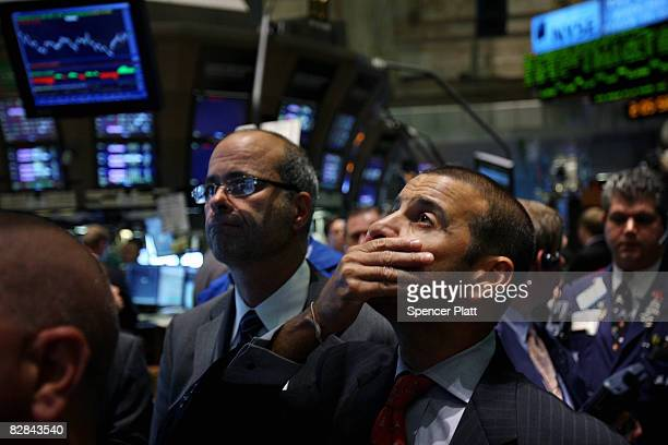Traders work on of the floor of the New York Stock Exchange September 16, 2008 in New York City. The Federal Open Market Committee met today and...