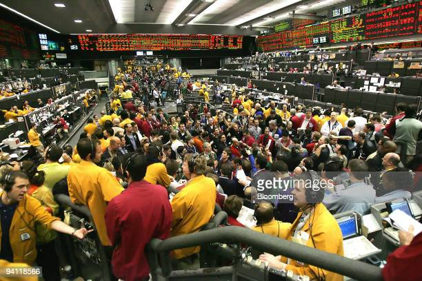 Traders work on the Eurodollars Options floor at the Chicago Mercantile Exchange in Chicago Illinois US on Monday Jan 28 2008 CME Group Inc the...