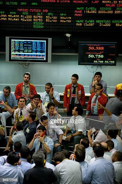 Traders work on the floor at the Brazilian Bolsa de Mercadorias e Futuros or Brazilian Mercantile and Futures Exchange in Sao Paulo Brazil on...
