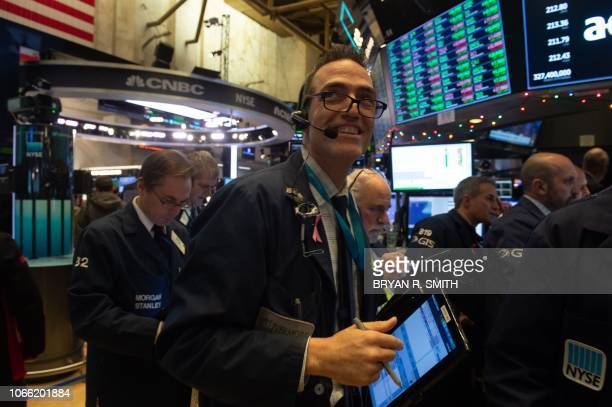 Traders work on the floor at the closing bell of the Dow Industrial Average on November 28 2018 in New York Wall Street stocks rallied Wednesday...