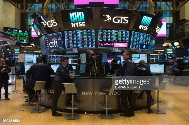 Traders work on the floor at the closing bell of the Dow Industrial Average at the New York Stock Exchange on January 2 2018 in New York Wall Street...