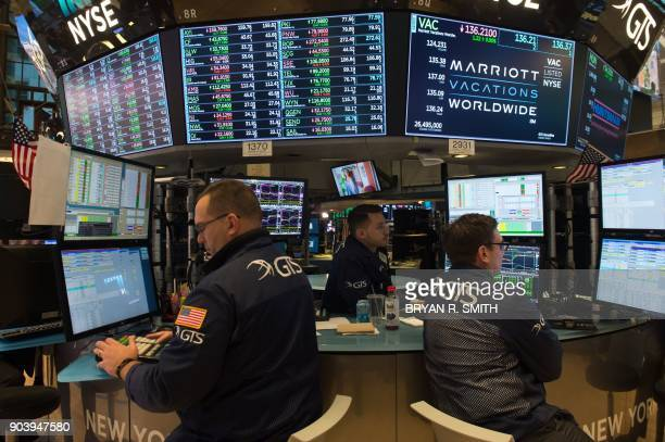 Traders work on the floor at the closing bell of the Dow Industrial Average at the New York Stock Exchange on January 11 2018 in New York Wall Street...