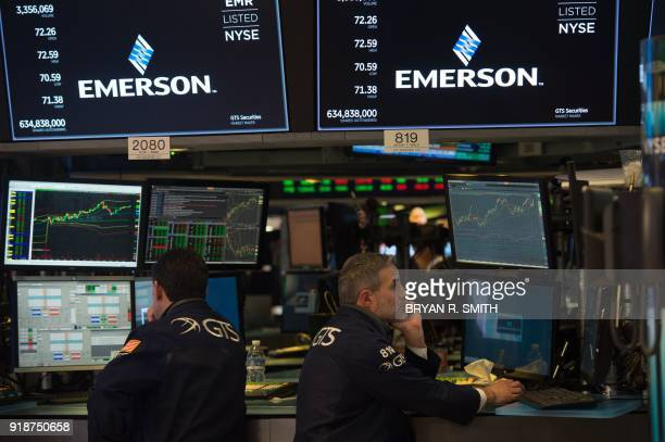 Traders work on the floor at the closing bell of the Dow Industrial Average at the New York Stock Exchange on February 15 2018 in New York Wall...