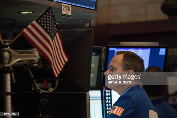 Traders work on the floor at the closing bell of the Dow Industrial Average at the New York Stock Exchange on March 15 2018 in New York / AFP PHOTO /...
