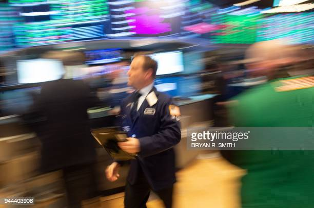 TOPSHOT Traders work on the floor at the closing bell of the Dow Industrial Average at the New York Stock Exchange on April 10 2018 in New York