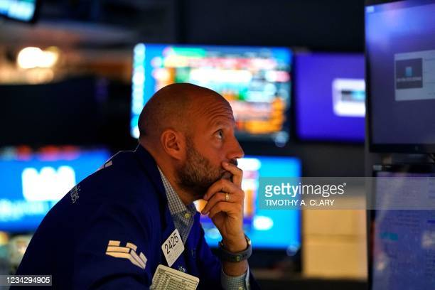 Traders work on the floor at the New York Stock Exchange in New York, on July 29, 2021. - Wall Street stocks climbed early July 29 following another...