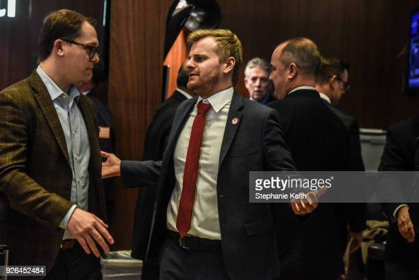 Traders work on the floor at the New York Stock Exchange on March 2 2018 in New York City President Donald Trump's announcement for new tariffs...