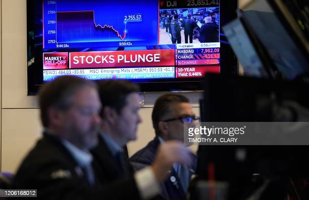Traders work on the floor during the opening bell on the New York Stock Exchange on March 9, 2020 in New York. - Trading on Wall Street was...