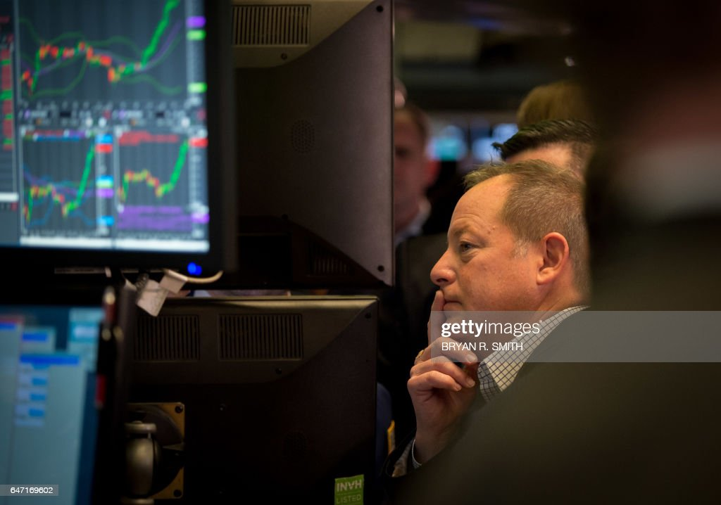 Traders work on the floor during the Snap Inc. IPO at the New York Stock Exchange, March 2, 2017 in New York. Snapchat surged in its debut trade Thursday, jumping more than 40 percent from the level set in the initial public offering Wednesday night. / AFP PHOTO / Bryan R. Smith