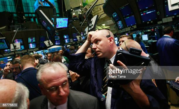 Traders work on the floor moments before the morning bell at the New York Stock Exchange November 21 2008 in New York City Stocks were up in morning...
