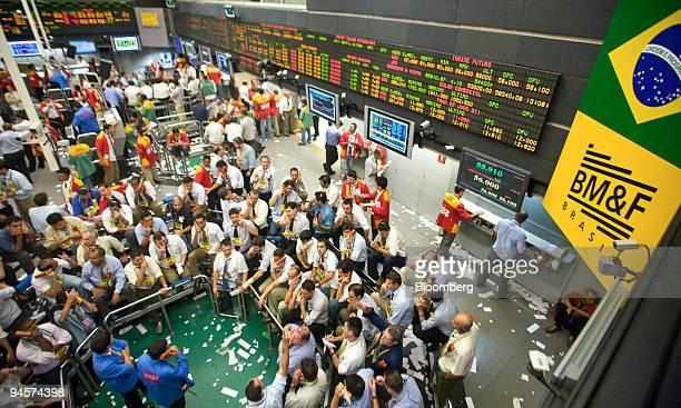 Traders work on the floor of the at the Brazilian Bolsa de Mercadorias e Futuros or Brazilian Mercantile and Futures Exchange in Sao Paulo Brazil on...