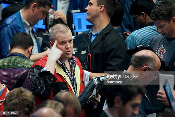 Traders work on the floor of the Chicago Board Options Exchange in Chicago Illinois US on Thursday April 2013 The CBOE opened for trading...