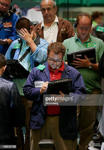Traders work on the floor of the New York Mercantile Exchange in New York US on Wednesday July 18 2012 US stocks rose for a second day as industrial...