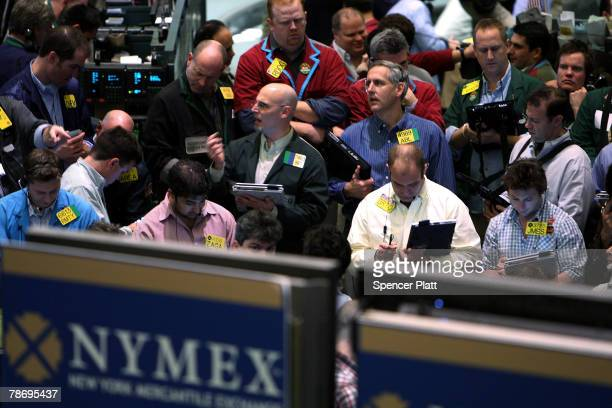 Traders work on the floor of the New York Mercantile Exchange January 2 2008 in New York City After much anticipation oil prices rose to $100 a...