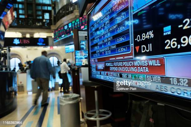 Traders work on the floor of the New York Stock Exchange after the Federal Reserve announced a cut in interest rates on July 31, 2019 in New York...