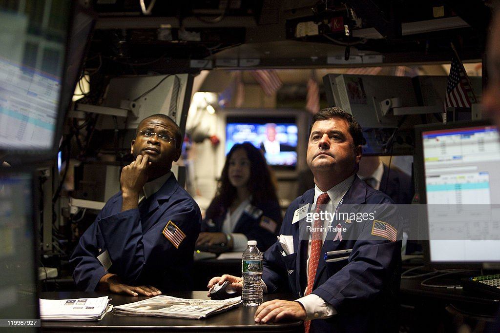 Traders work on the floor of the New York Stock Exchange after the opening bell on July 28, 2011 in New York City. The Dow Jones Industrial Average was up slightly during the morning trading as the world's markets monitor the clash between the White House and House Republicans over the nation's debt ceiling.
