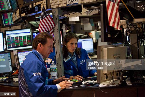 Traders work on the floor of the New York Stock Exchange after the opening bell on July 28 2011 in New York City The Dow Jones Industrial Average was...