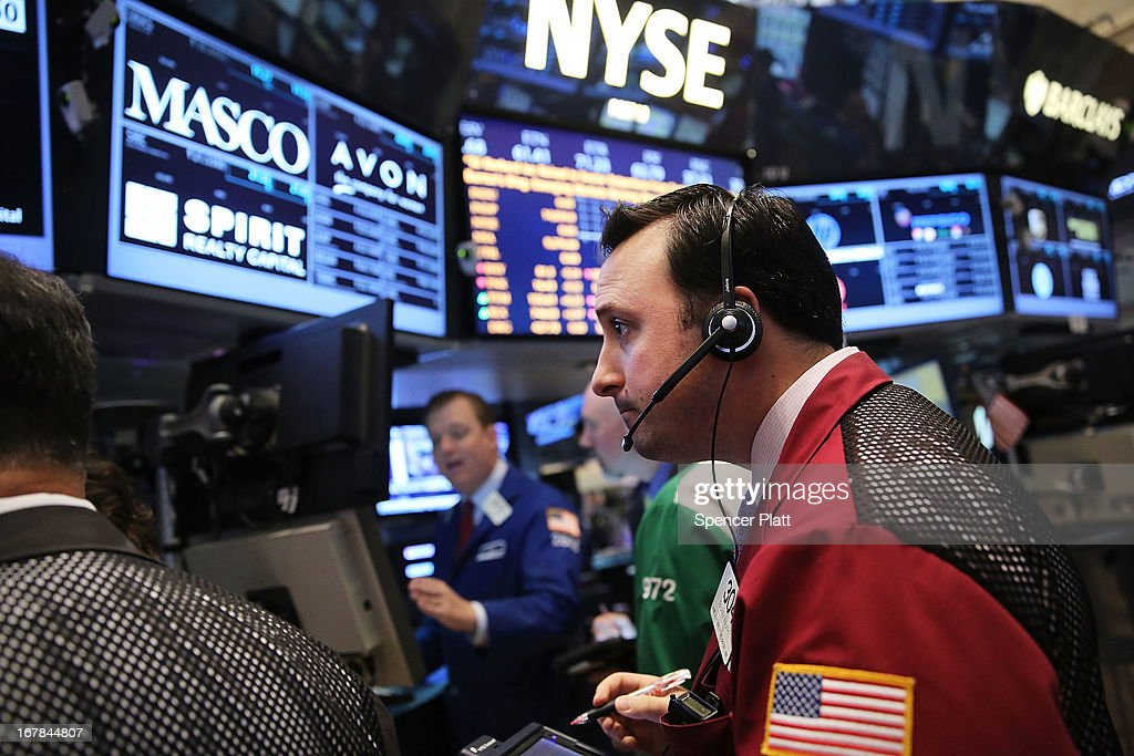 Traders work on the floor of the New York Stock Exchange after the morning bell on May 1, 2013 in New York City. As investors wait for the Federal Reserve's policy-making committee to conclude its two-day meeting, the Dow Jones industrial average, S&P 500 and the Nasdaq all declined 0.4% in morning trading.