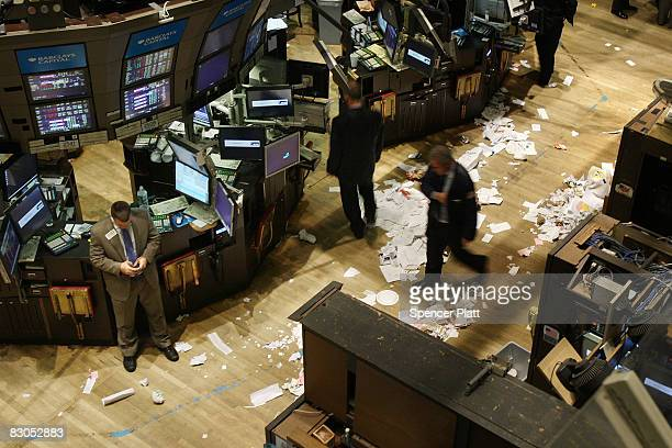 Traders work on the floor of the New York Stock Exchange after the closing bell September 29 2008 in New York City US stocks took a nosedive in...