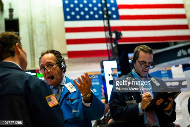 Traders work on the floor of the New York Stock Exchange ahead of the closing bell on August 15 2018 in New York City US stocks fight to avoid a hard...