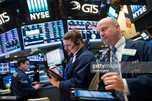 Traders work on the floor of the New York Stock Exchange , April 7, 2017 in New York City. Following U.S. Strikes in Syria and a weaker than expected...