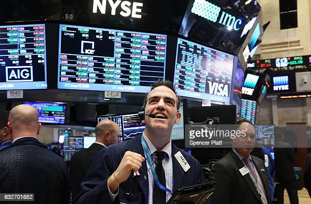 Traders work on the floor of the New York Stock Exchange as the Dow Jones industrial average closed above the 20000 mark for the first time on...