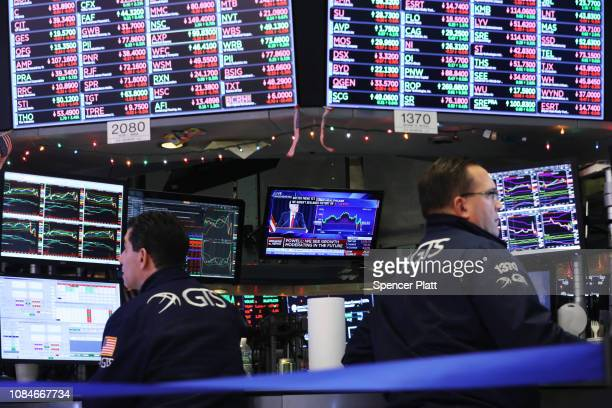 Traders work on the floor of the New York Stock Exchange as the Federal Reserve Board Chairman Jerome Powell holds a news conference on December 19...