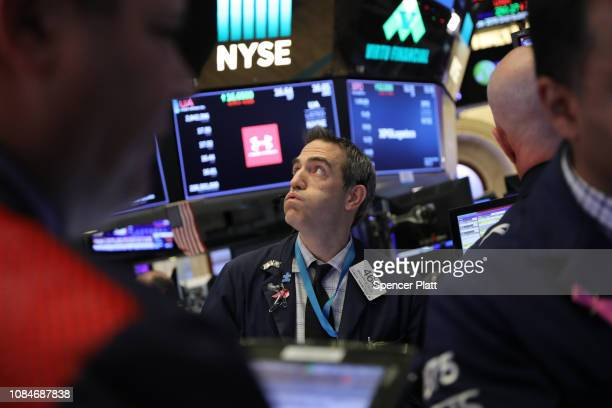 Traders work on the floor of the New York Stock Exchange as the Federal Reserve Board Chairman Jerome Powell holds a news conference on December 19,...