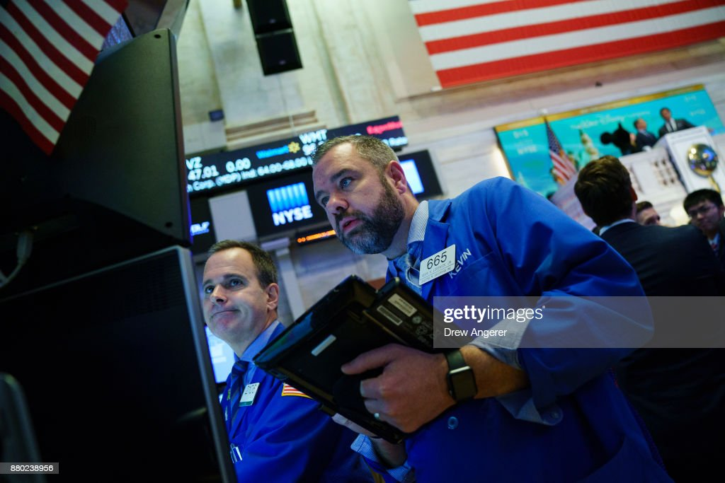 Traders work on the floor of the New York Stock Exchange (NYSE) at the opening bell, November 27, 2017 in New York City. Disney is marking the company's 60th anniversary as a listed company on the NYSE.