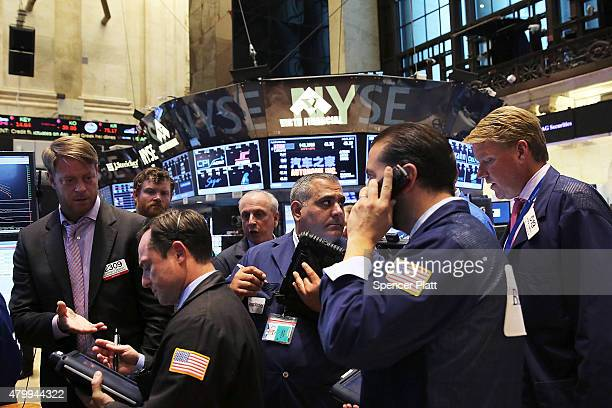 Traders work on the floor of the New York Stock Exchange at the close of the day after trading was paused for nearly four hours due to a 'technical...