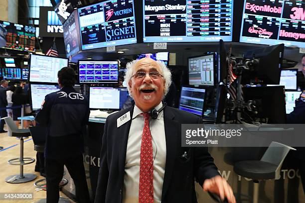 Traders work on the floor of the New York Stock Exchange at the close of the trading day on June 28 2016 in New York City Following days of market...