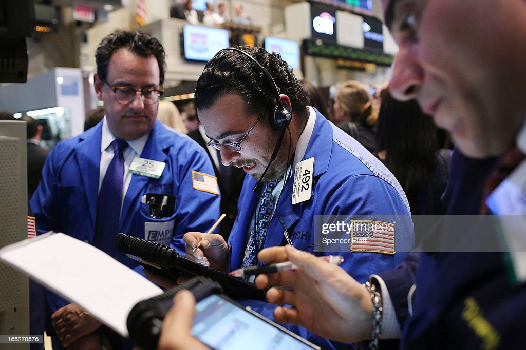Traders work on the floor of the New York Stock Exchange at the end of the trading day on April 2, 2013 in New York City. The Dow Jones Industrial average and the S&P 500 rose to new record highs on April 2, with the Dow finishing at a record close of 14,662. All three major indexes are up between about 10 percent and 12 precent for the year.