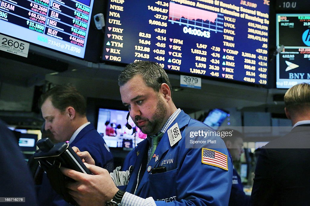 Traders work on the floor of the New York stock Exchange at the end of the trading day on April 5, 2013 in New York City. Following news of a disappointing jobs report, U.S. stocks fell Friday.The Dow Jones industrial average lost more than 40 points, or 0.3%, while the S&P 500 fell 0.4%.