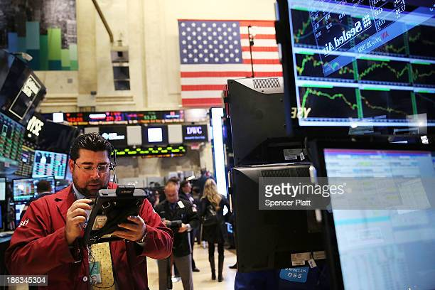 Traders work on the floor of the New York Stock Exchange at the end of the trading day on October 30 2013 in New York City In a highly expected move...