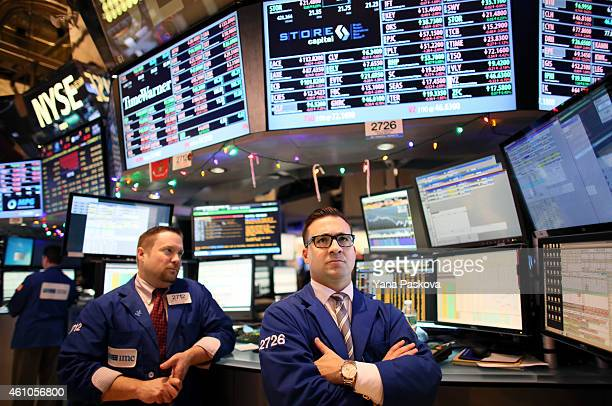 Traders work on the floor of the New York Stock Exchange at the end of the trading day on January 05 2015 in New York City US stocks fell over 330...