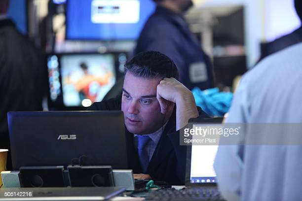 Traders work on the floor of the New York Stock Exchange at the end of the day on January 15 2016 in New York City Stocks have fallen significantly...