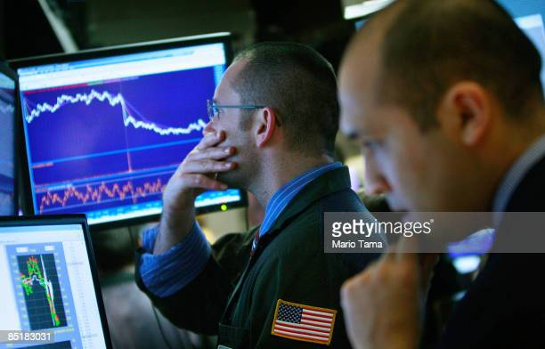 Traders work on the floor of the New York Stock Exchange at the end of the trading day March 2 2009 in New York City Stocks closed down 29964 or 42...