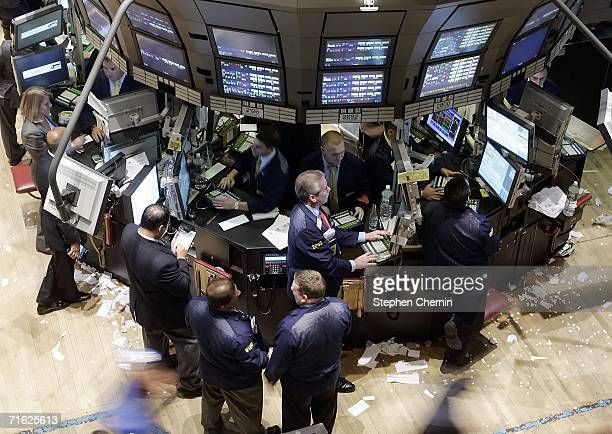 Traders work on the floor of the New York Stock Exchange August 10 2006 in New York CityThe Dow closed up 48 at 11124 as light crude oil dropped $235...