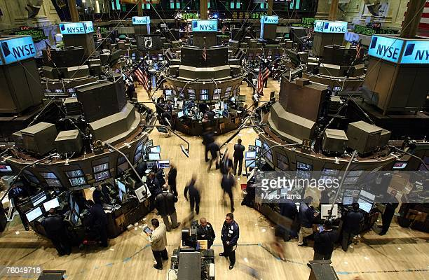 Traders work on the floor of the New York Stock Exchange August 10 2007 in New York City Stocks were trading flat after the Federal Reserve stated it...