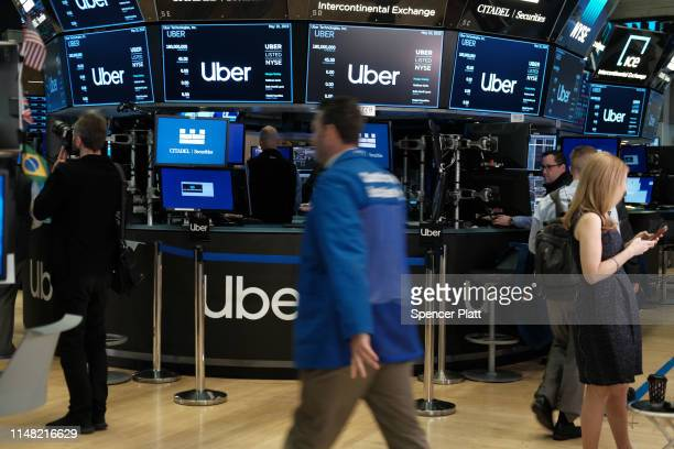 Traders work on the floor of the New York Stock Exchange before the Opening Bell at the NYSE as the ride-hailing company Uber makes its highly...