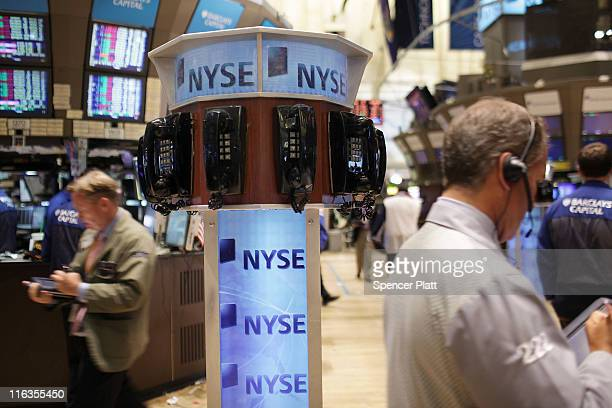Traders work on the floor of the New York Stock Exchange before the close on June 15 2011 in New York City Reversing much of the previous day's gains...